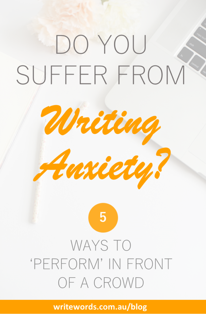 Laptop, pen and flowers with text overlay – Do you suffer from writing anxiety? 5 ways to perform in front of a crowd
